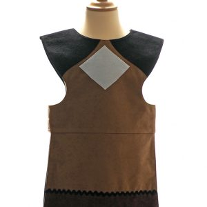 Front view of floppy eared dog tabard. Honey-coloured with black shoulders, white diamond shape at centre front. Black band and dark brown bands at the bottom, decorated with black and white ric rac braid.