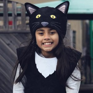 A girl wearing the black cat hood and tabard.