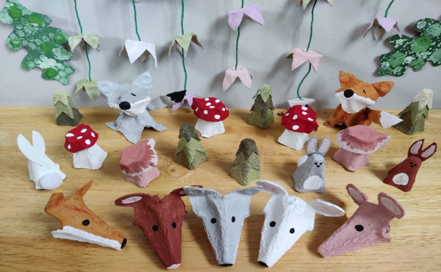 Image showing a variety of woodland-themed egg box crafts which include animal finger puppets, rabbits, toadstools, mushrooms, a fox, a wolf and a flower mobile.